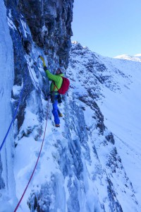 Me reaching the belay below the roof