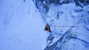 Guy seconding up to the belay below the huge roof