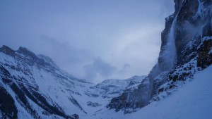 An atmospheric Headwall with spindrift pouring down most of the routes.