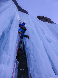 Me moving up the last steep ice section as night closes in. Credit. Nick Bullock